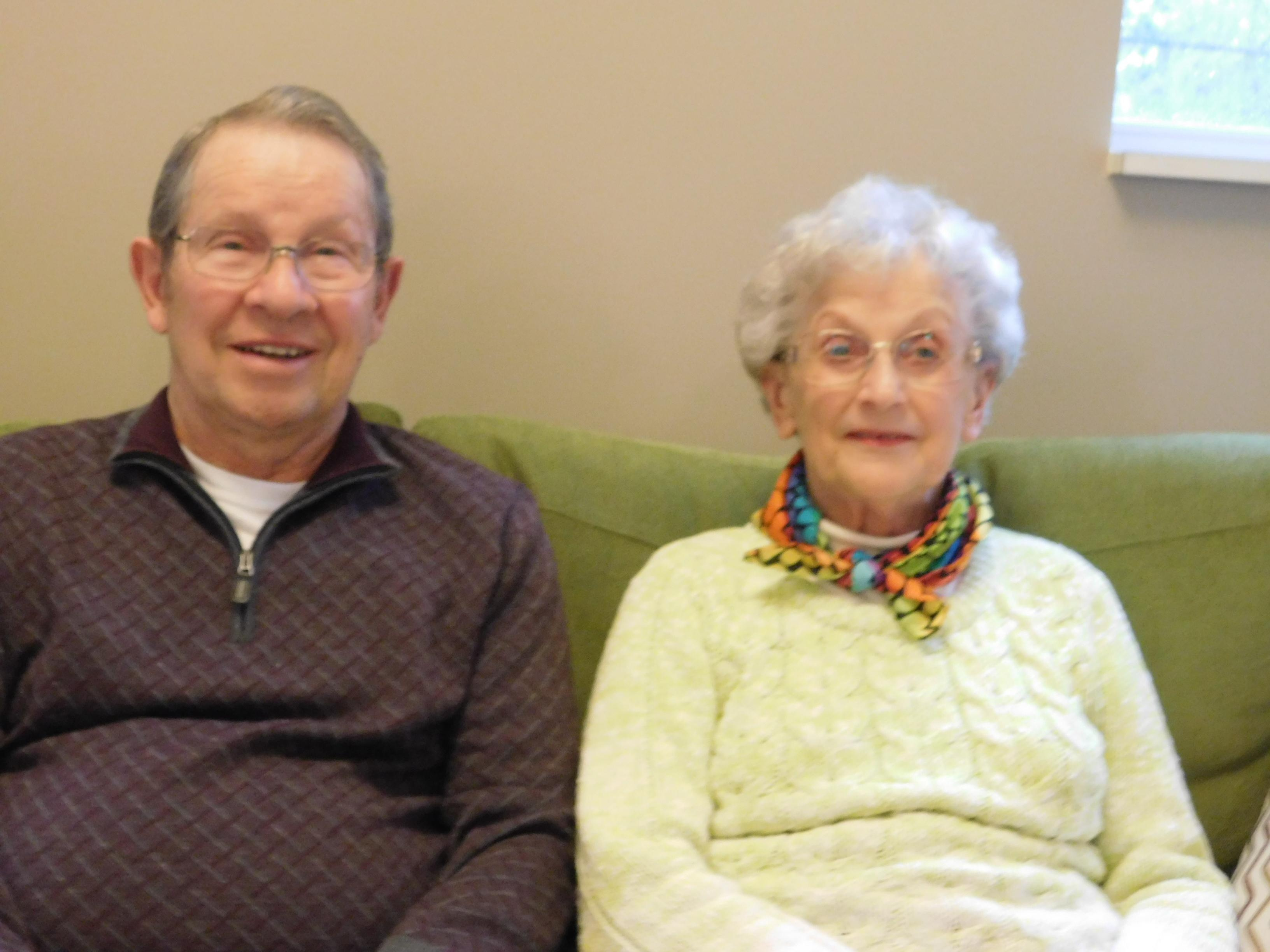 John and Betty walker sitting on a couch posing for the camera